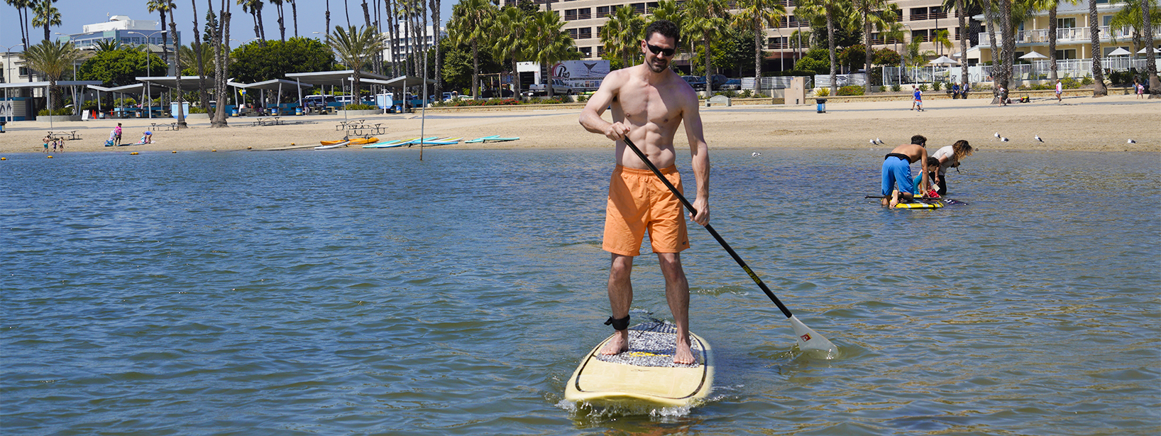 Doctor Michael Wells paddle surfing